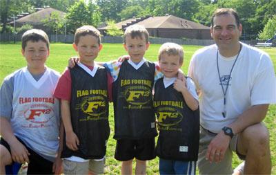 Mark Catlett posing with kids